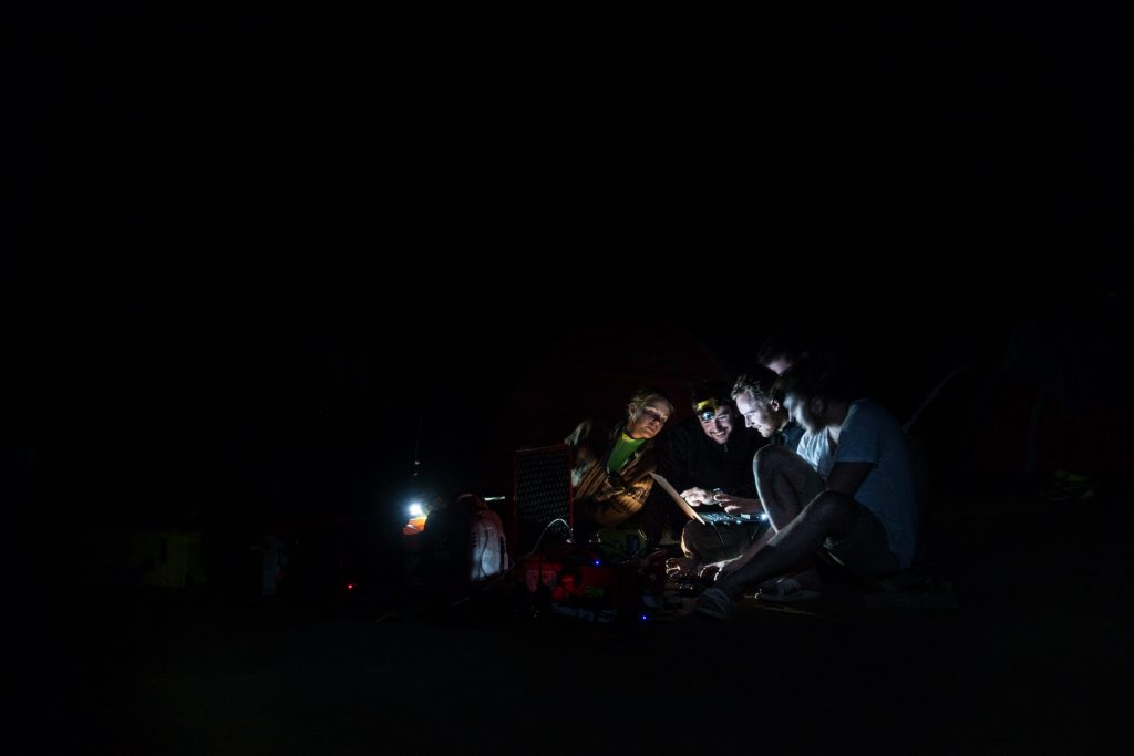 The #SonDoong360 team working together from a single laptop in the darkness of the largest cave in the world, Son Doong