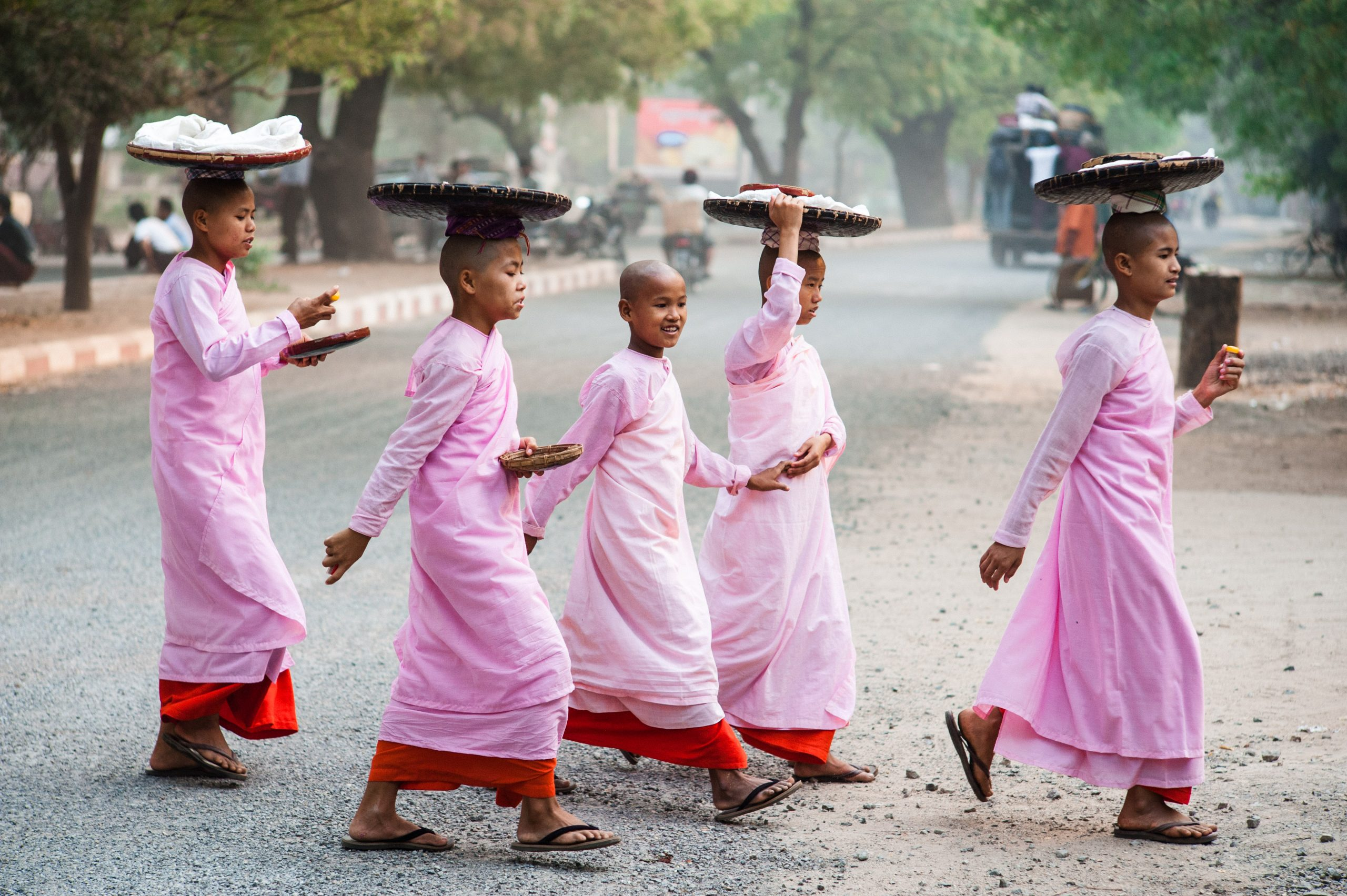 Nuns out on an early morning pindapata - food collection - in their home town of Bagan, Nyaung U, Mandalay Region, Burma. One of Martin Edström's 10 remarkable images.