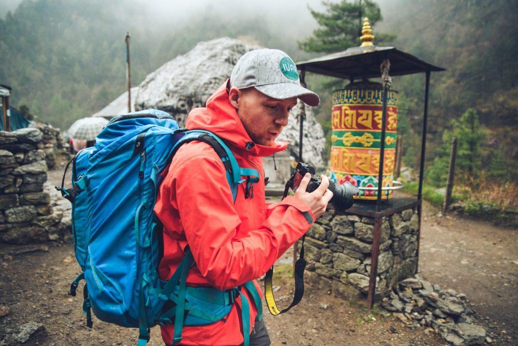 Martin Edström holding a camera in Nepal.